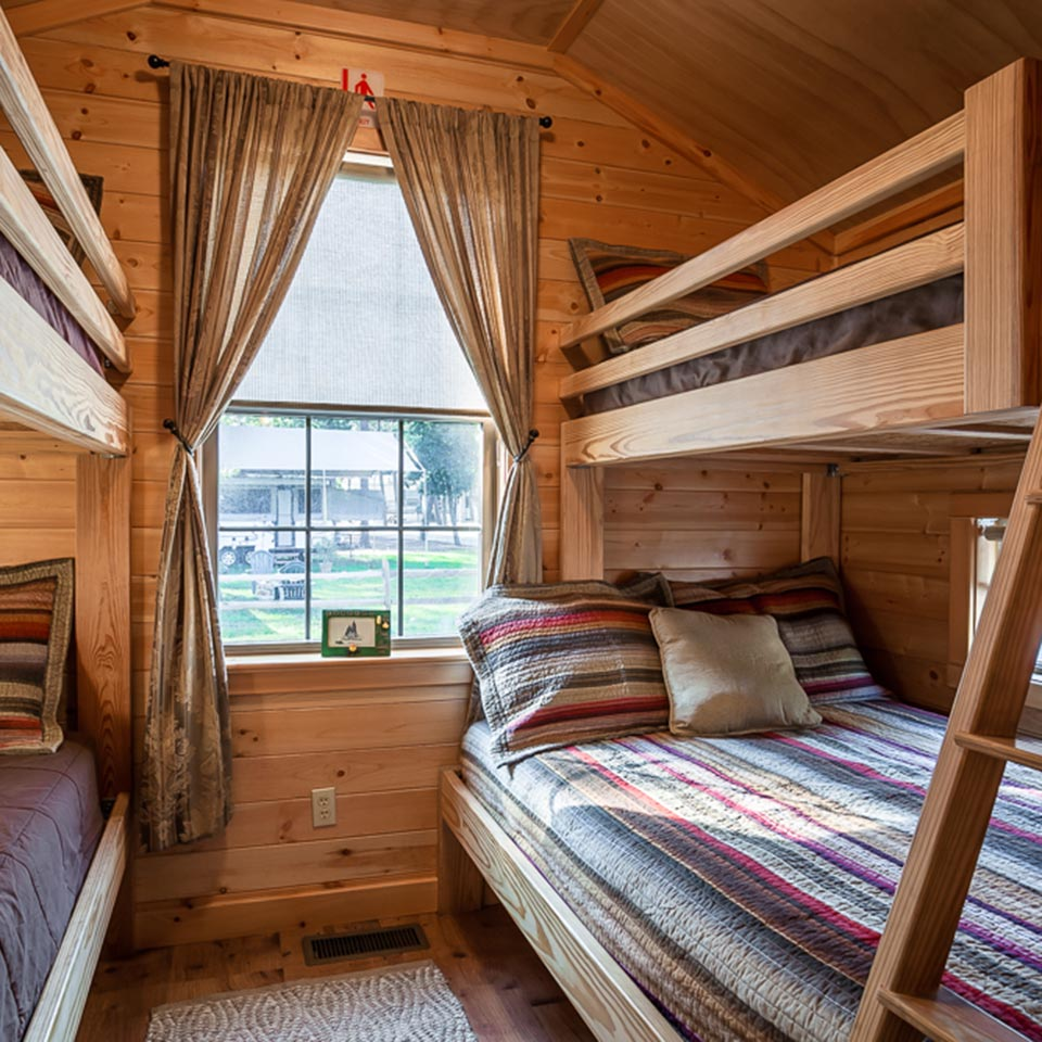 Bedroom in a cabin at Lake James Camping Resort & Marina