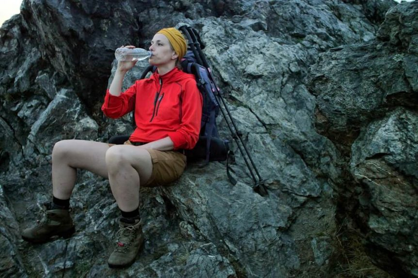 Hiker drinking from water bottle