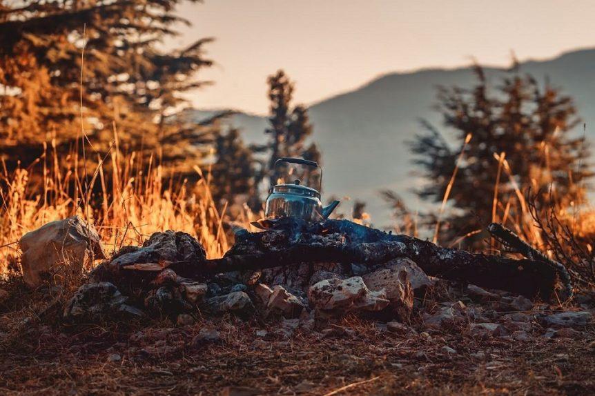 Tea kettle sitting on campfire